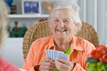 smiling lady playing cards