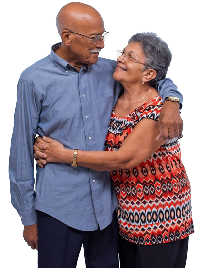 Elderly couple standing, hugging and looking at each other